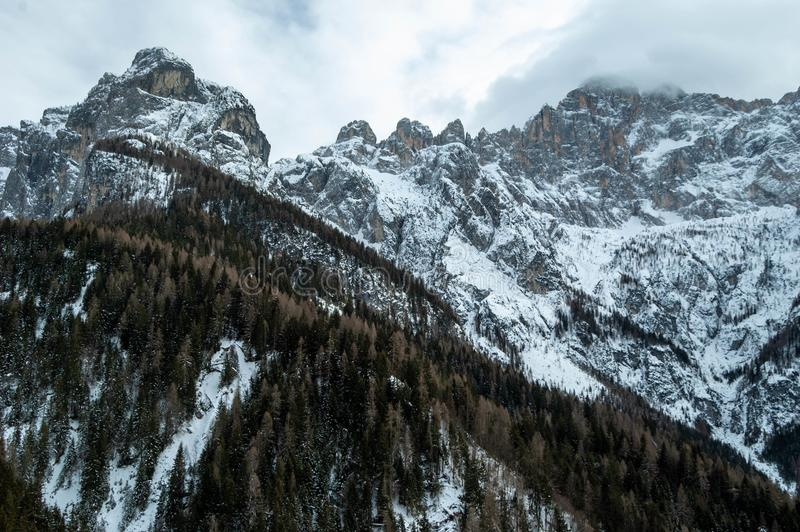 View of Civetta in Dolomite mountains in Italy on winter day stock photos