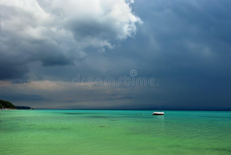 Holiday at the stormy paradise beach royalty free stock photos