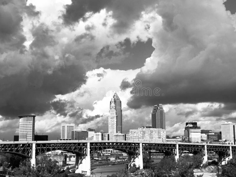 A view of Cleveland & Clouds from Tremont in Black & White - railroad - OHIO - USA. The bustling downtown core is known for sports venues like the Q Arena stock photography