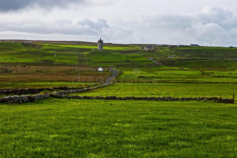 View at Cliffs of Moher with guard tower from Doolin, Ireland stock images