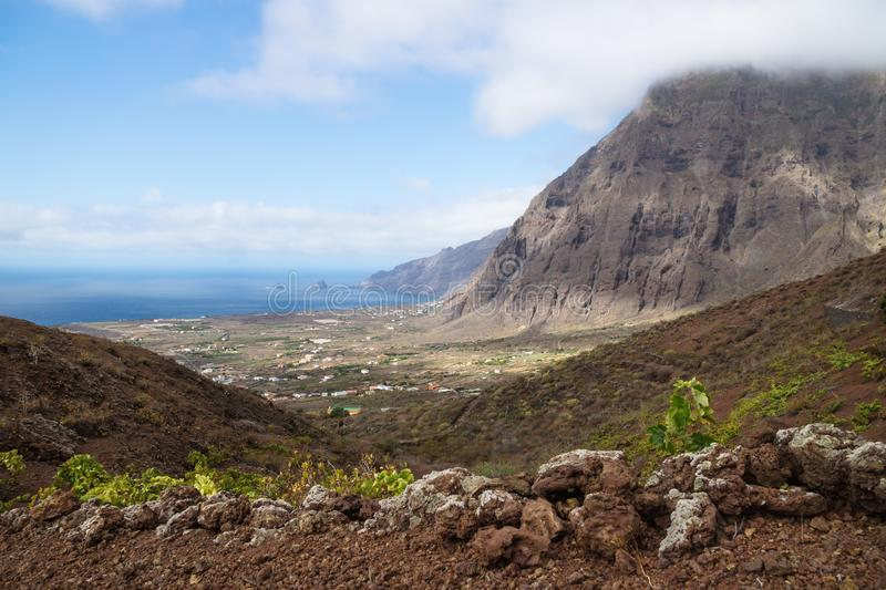 View on the cliffs and red hills of El Golfo valley, Frontera, El Hierro, Canary Islands, Spain. View on the cliffs and red hills of El Golfo valley until the stock images