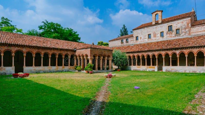 Cloister and garden of San Zeno Maggiore Basilica, a landmark Romanesque church in Verona, Italy stock photos