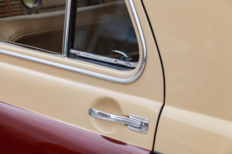 View on closed rear door with handle and corner wondow of the old Russian retro vintage car of the executive class released in the stock image