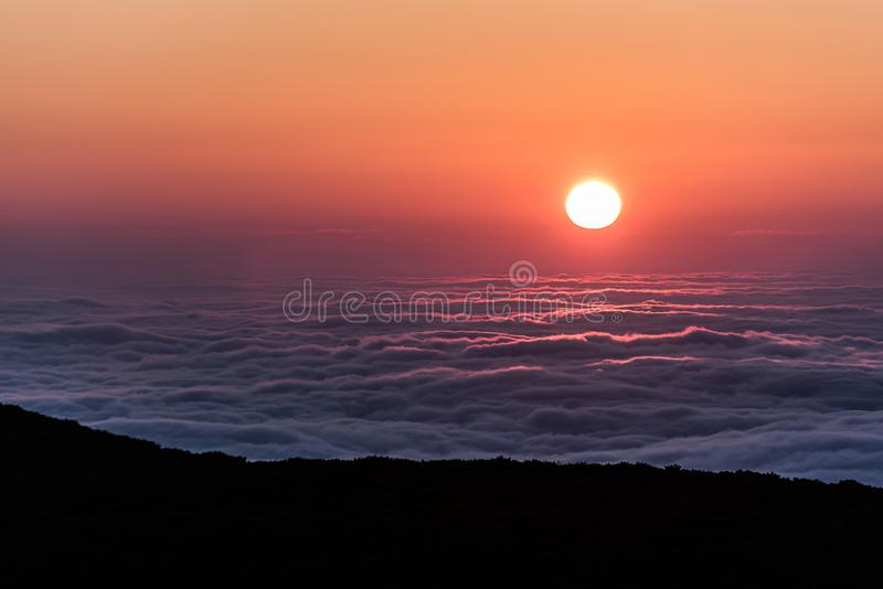 A cloud inversion along Shenandoah National Park at sunrise. A view of a cloud inversion along Shenandoah National Park in Virginia at sunrise stock image