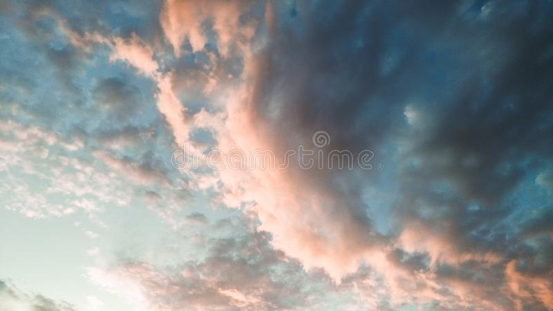A view of clouds at the sunset time. Sky, cloudy, day, background, abstract, texture, element, design, nature, natural, nice, beauty, zooming, landscape, photo royalty free stock photo