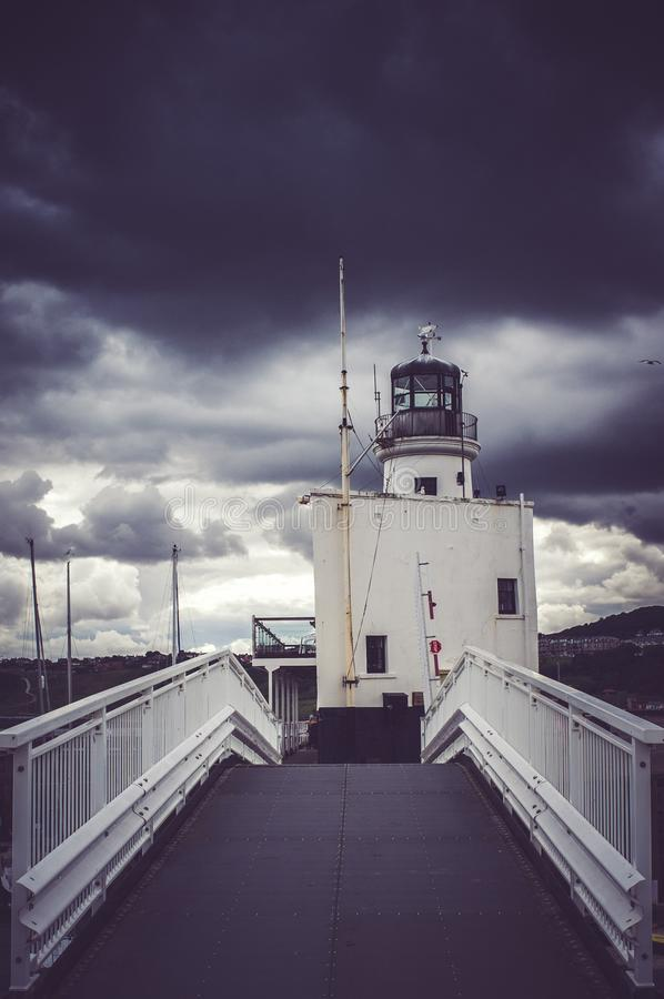 View of Cloudy Skies on Lighthouse royalty free stock photography