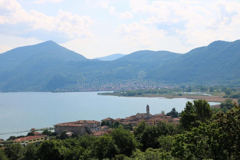 Clusane, Lake Iseo, Italy. View on Clusane, a small historic village on the southern end of lake Iseo, the fourth largest lake in Lombardy, Italy. There are royalty free stock images