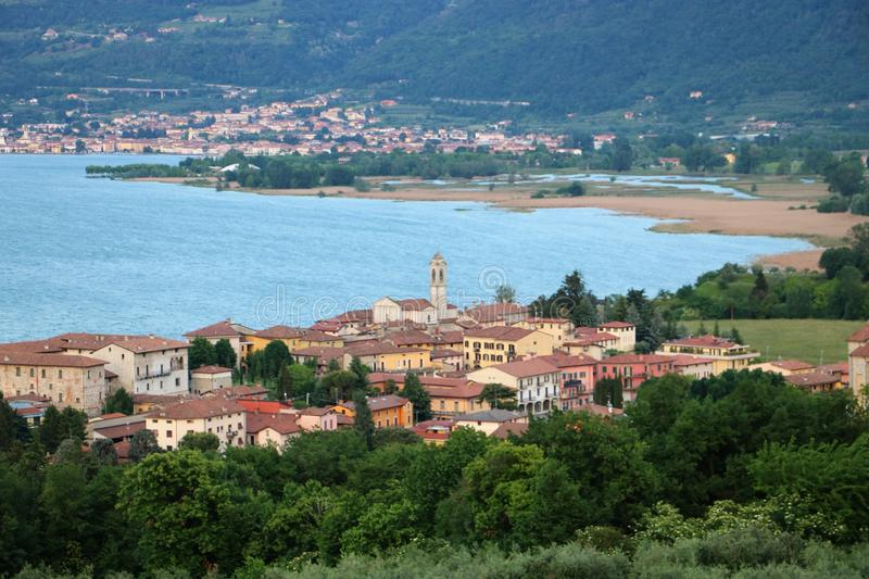 Clusane, Lake Iseo, Italy. View on Clusane, a small historic village on the southern end of lake Iseo, the fourth largest lake in Lombardy, Italy. There are stock photography