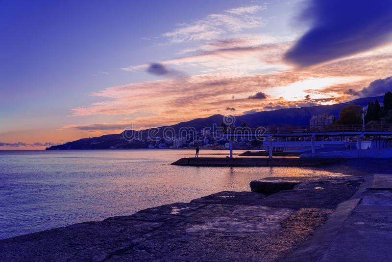 View of the coastline sea and rocks at sunset against a natural blue sky. Massandra beach, Yalta, Crimea royalty free stock photos