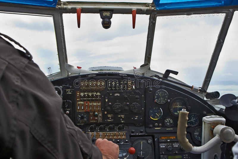 View in the cockpit. A view in the cockpit with a pilot stock image