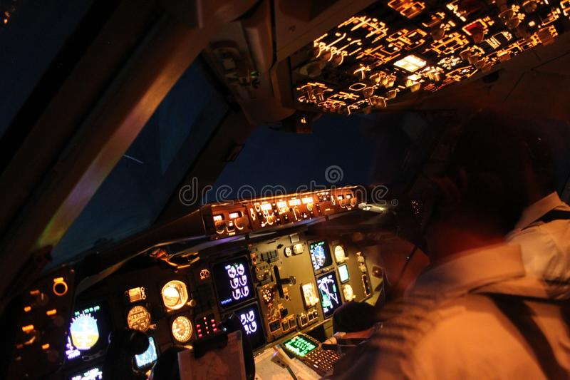 Airliner cockpit by night royalty free stock images