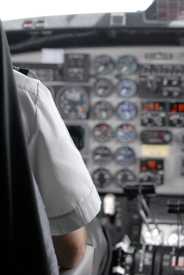 View of a cockpit and pilot royalty free stock photography