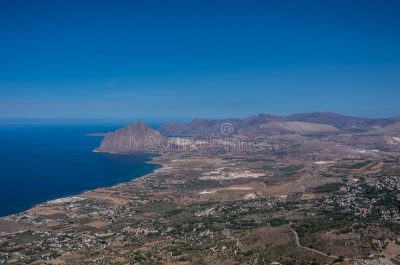 View of Cofano mount and the Tyrrhenian coastline from Erice, Si. Cily, Italy royalty free stock image