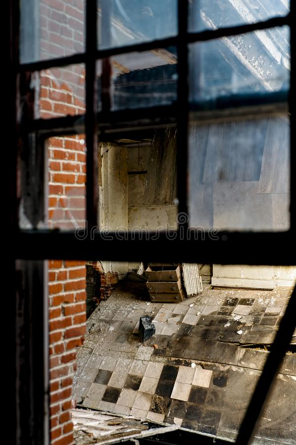 Collapsing Room - Abandoned Knox County Infirmary - Ohio. A view of a collapsing room at the abandoned Knox County Infirmary near Mt. Vernon, Ohio royalty free stock image