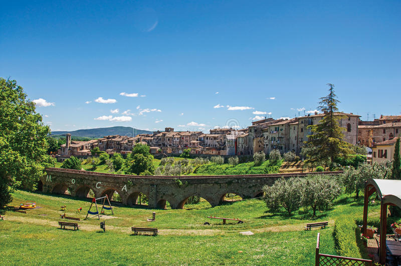 View of Colle di Val d`Elsa town with bridge and vegetation at the front. stock image