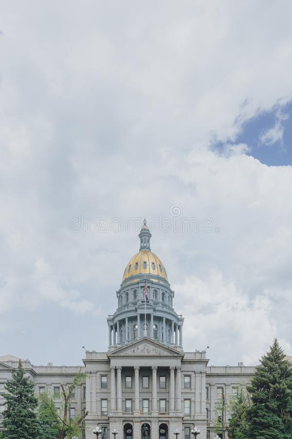 Colorado State Capitol under clouds and sky in downtown Denver, USA royalty free stock photography