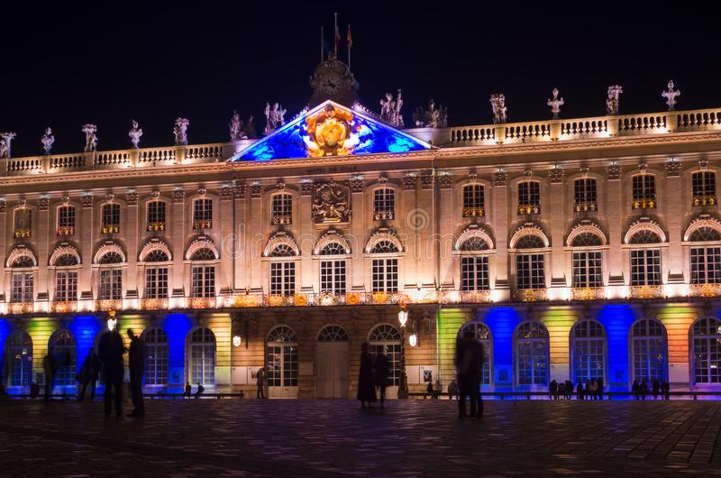 View of the colorful illuminated historical building of the Hotel de Ville in Nancy at night. The city hall Hotel de Ville or Stanisla's Palace is a stock photos