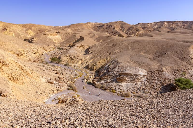View of the colorful mountains and valley of Eilat Red Canyon against the blue sky royalty free stock images