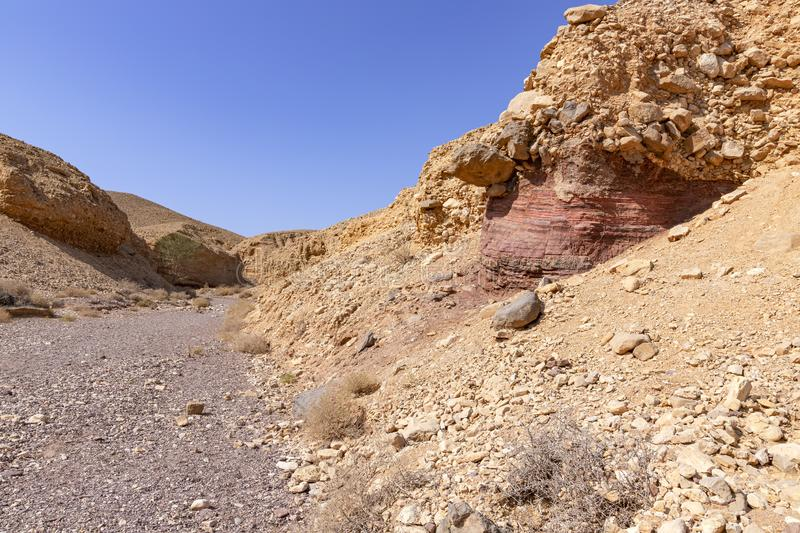 View of the colorful mountains and valley of Eilat Red Canyon against the blue sky stock image