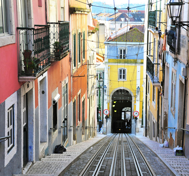 View of the colorful street with rails in Lisbon. LISBON, PORTUGAL - DECEMBER 28: View of the colorful street with rails in Lisbon on December 28, 2012. Lisbon royalty free stock photo