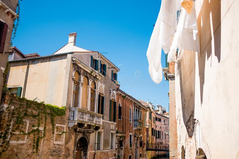 Venice, Italy - 10 may 2019: view from below of calatrava bridge  during sunny summer day with people walking on it and boats. View from below of calatrava royalty free stock photography