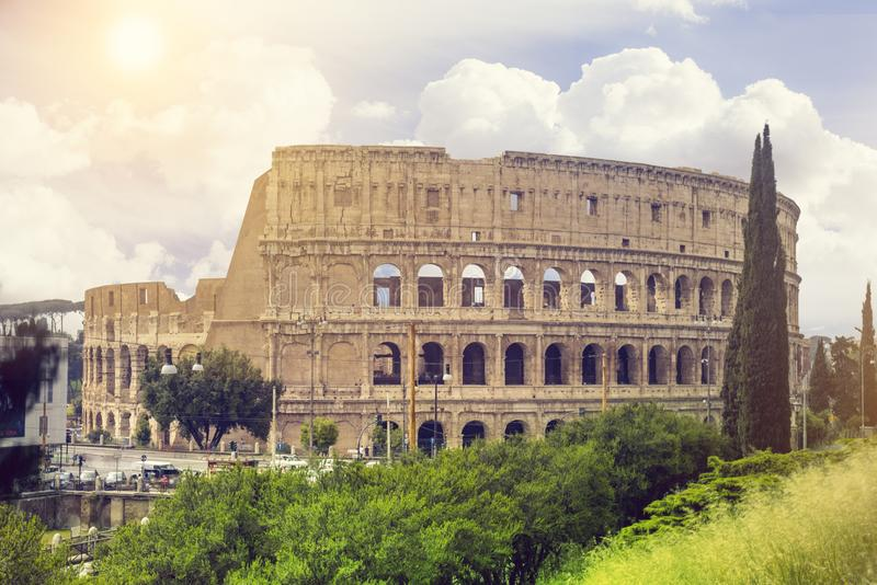 View of Colosseum in Rome and morning sun, Italy, Europe. Tourist attraction landmark stock images