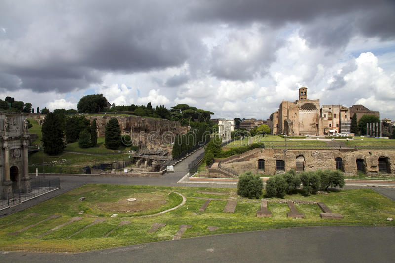 View from Colosseum to Palatine hill. A view from the Colosseum to the Palatine hill and the area with the arch of Constantine, Rome, Italy royalty free stock photography