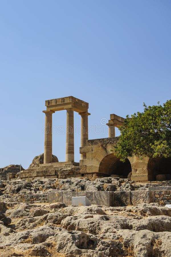 View of the columns of the acropolis in the city of Lindos. Rhodes, Greece.  stock photos