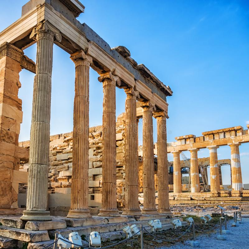 View of columns of Erechtheion and Parthenon on Acropolis, Athens, Greece against blue sky stock photo