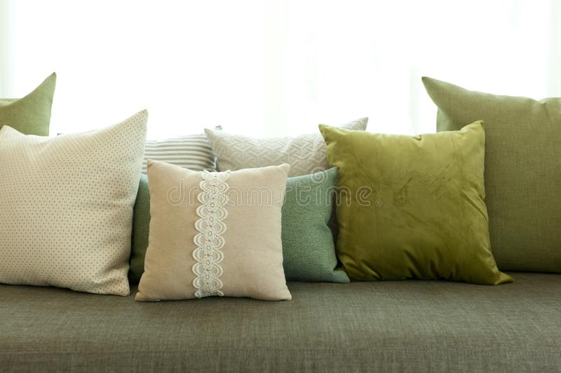 Comfortable modern corner couch sofa with many pillows stock photo