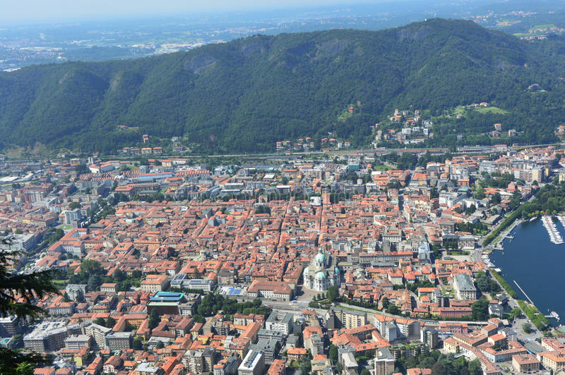 View of Como city from Brunate, panorama, viewpoint, belvedere, with mountains on the bottom, Como, Italy summer 2016 stock photo