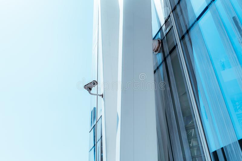 Surveillance video cam outdoors on the beam of the skyscraper royalty free stock photo