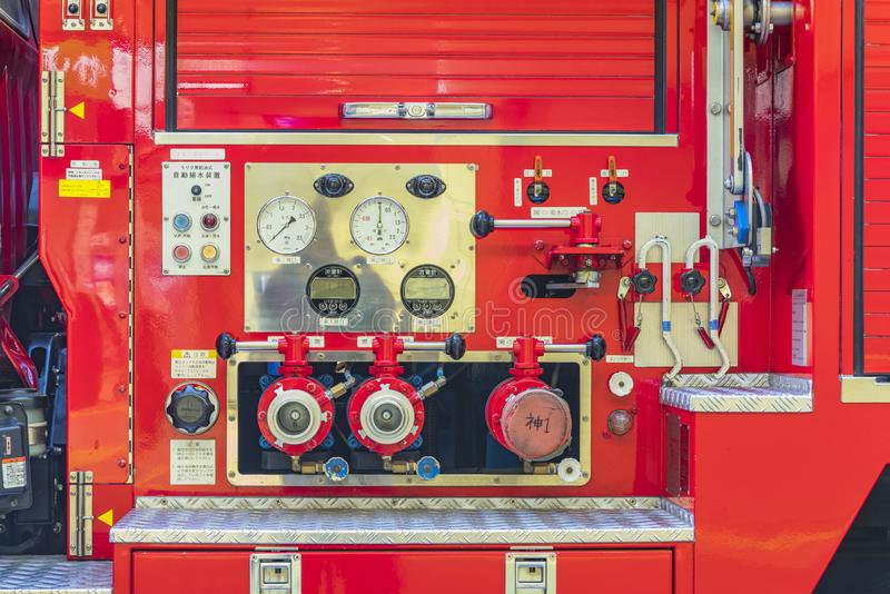 View of the control station of the water pressure valves of a Japanese fire truck stock images