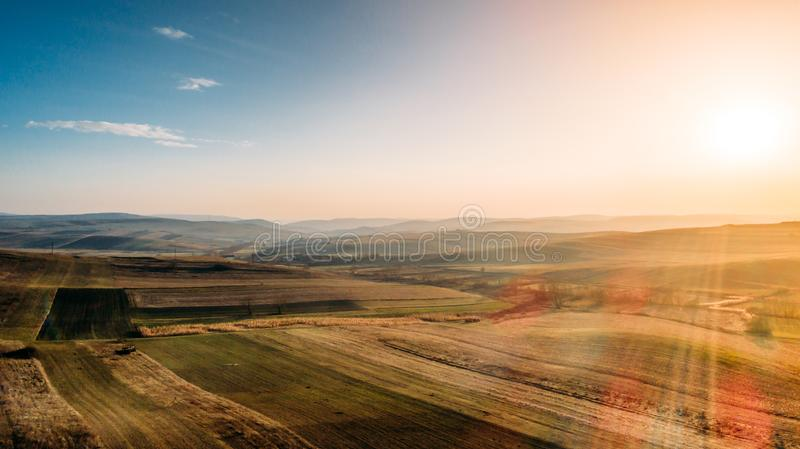 view of corn fields, beautiful hills landscape with drone photography stock image
