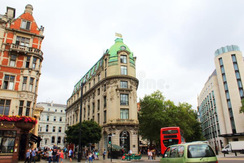 Central London buildings junction England United Kingdom. View of the corner buildings at the junction of Strand ,Wellington Street and Aldwych in Central London royalty free stock images