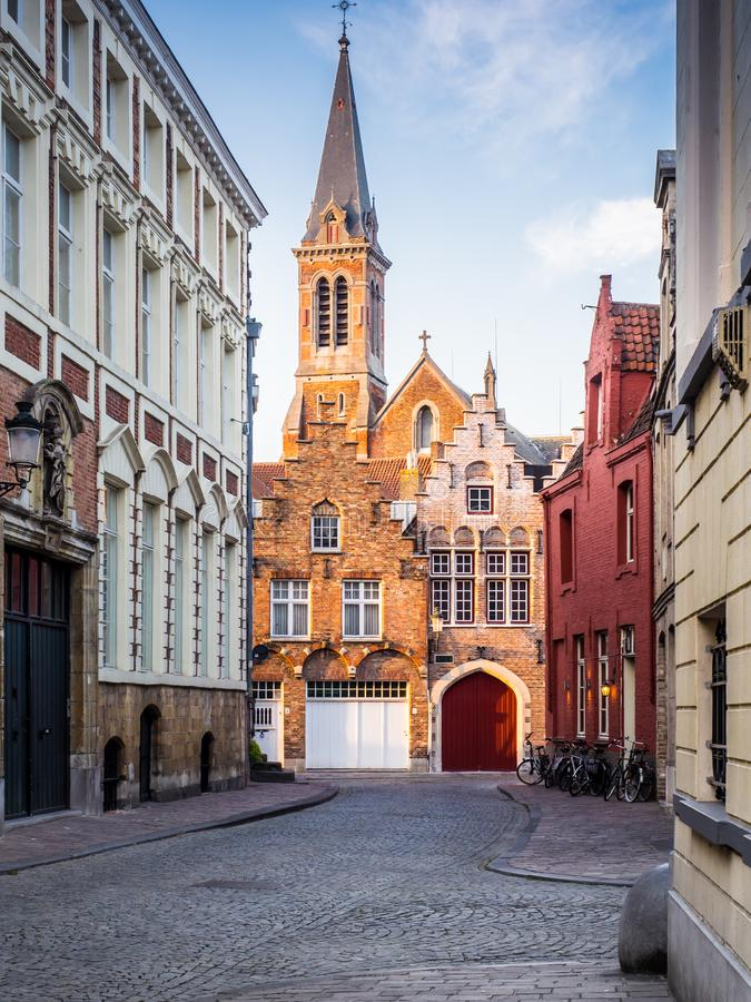 008-19 Bruges` street with church stock images