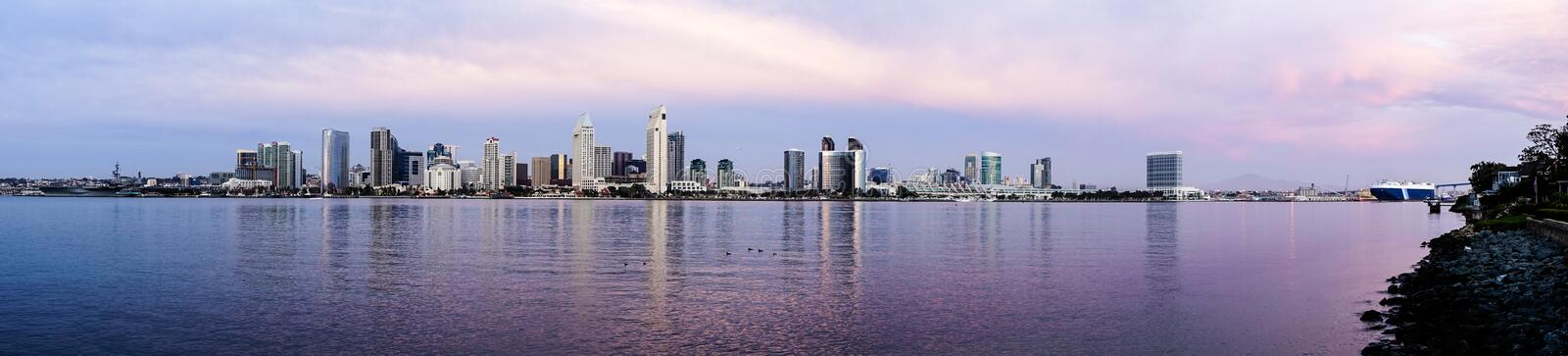 Long Panoramic View San Diego Waterfront Downtown City Skyline. View from Coronado Island of the bay and buildings of San Diego at dusk royalty free stock photo