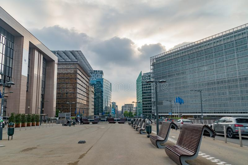View between Council of the European Union and Berlaymont, European Commission headquarters buildings at sunset time. Brussels, Belgium - June 5, 2019: View royalty free stock photography