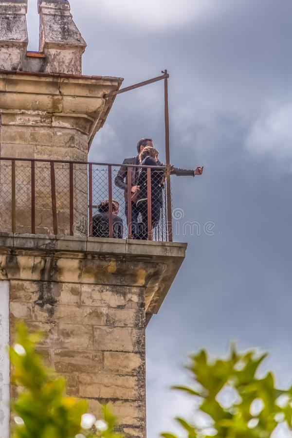 View of a Couple of tourists on the balcony of the Royal Palace of Coimbra, dazzling view of the city of Coimbra. Coimbra / Portugal - 04 04 2019 : View of a royalty free stock image