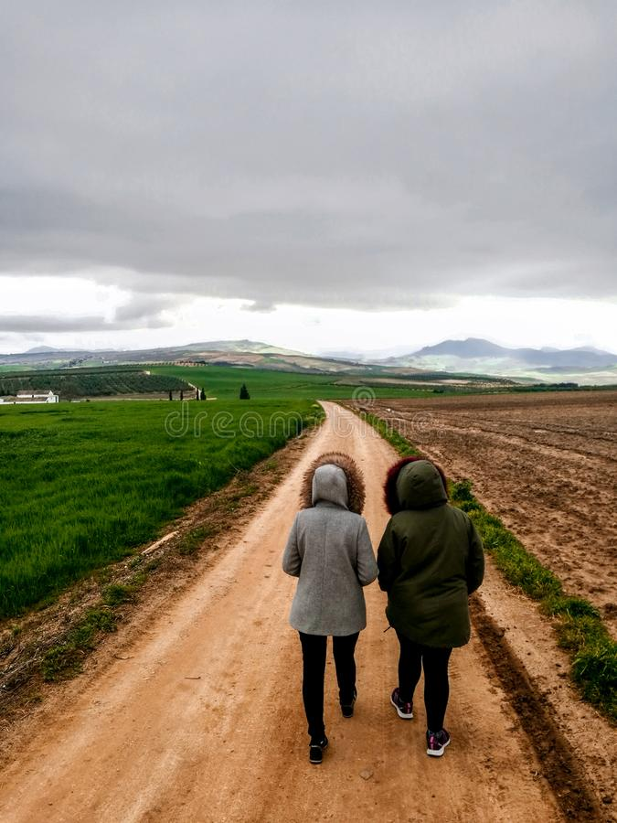 View of couple walking on a dirt road in beautiful parkland. In Spain landscape adventure healthy lifestyle motion motivation mountain bike tree woodland action royalty free stock photo