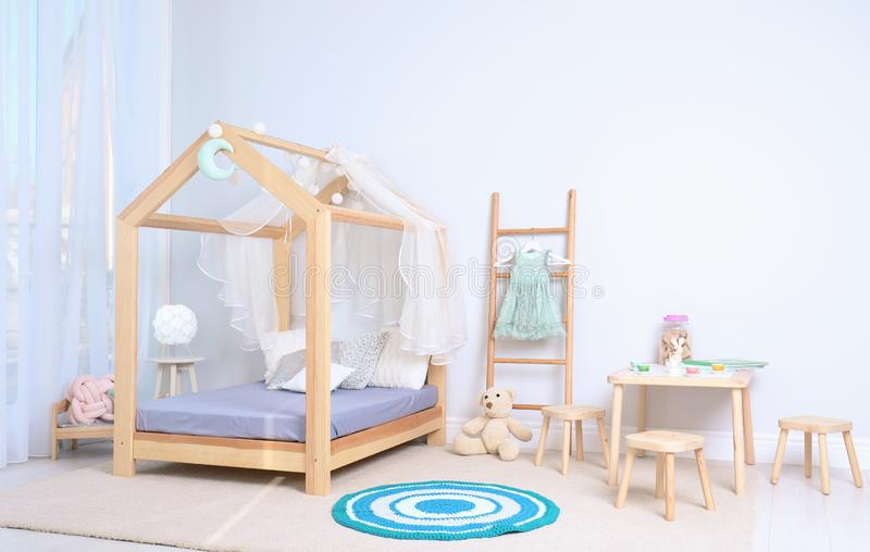 View of cozy child`s room interior. With cute bed royalty free stock photos