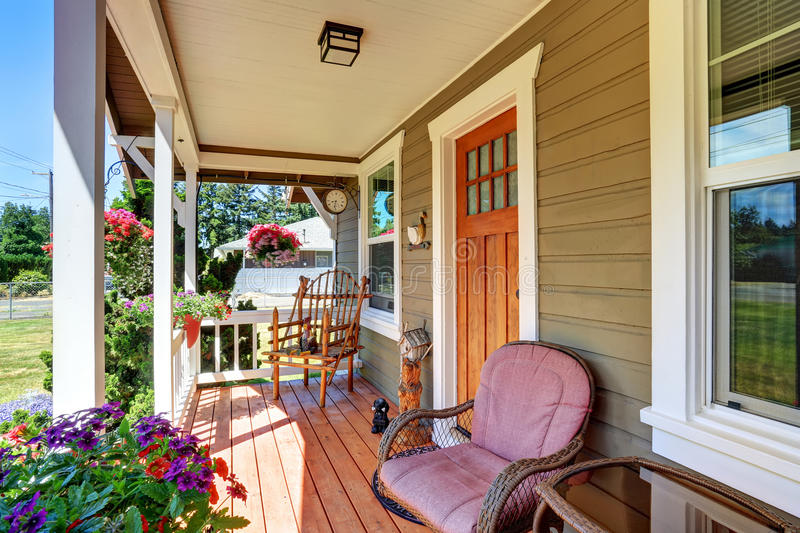 View of cozy covered porch with chairs and flower pots. View of cozy small covered porch with chairs and flower pots. Northwest, USA royalty free stock photography