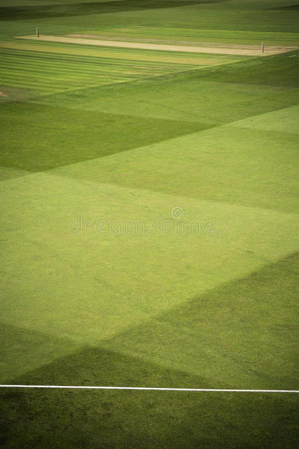Cricket pitch with stumps and boundary rope. View of cricket pitch on sunny day before start of play royalty free stock photos