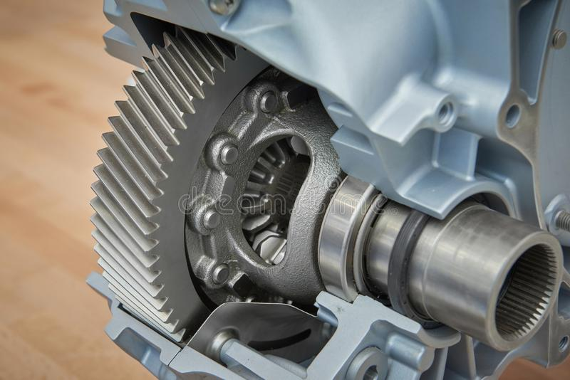 View on cross section of new car truck differential with visible gears bearings on shaft seals cone gears. Tractor truck car gearb. Ox differential. New clean stock photo