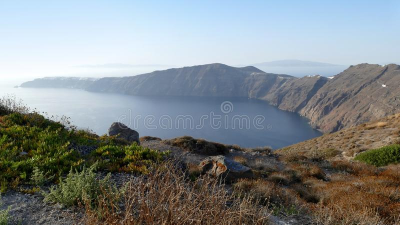 View of the curving bay towards Oia in Santorini, Greece stock photography