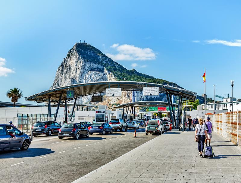 View at customs infrastructure at Spanish side in La Linea town. Rock of Gibraltar at background - British oversee territory stock photography