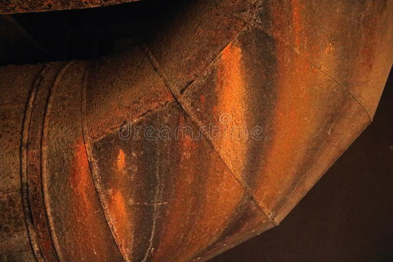 STAINS AND ROUGH TEXTURE ON LARGE OXIDISED PIPE royalty free stock image