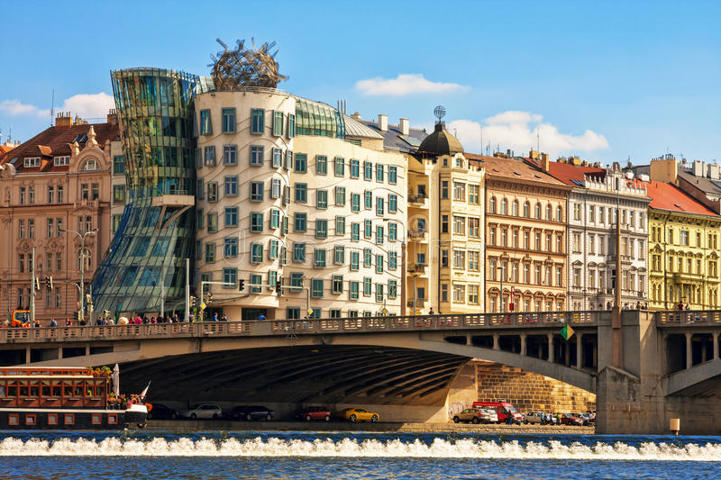 View of the Dancing house and embankment of the Vltava river. stock photography