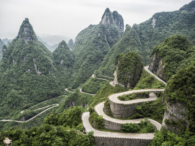 A view of the dangerous 99 curves at the Tongtian Road to Tianmen Mountain, The Heaven`s Gate at Zhangjiagie, Hunan Province, Ch stock photography