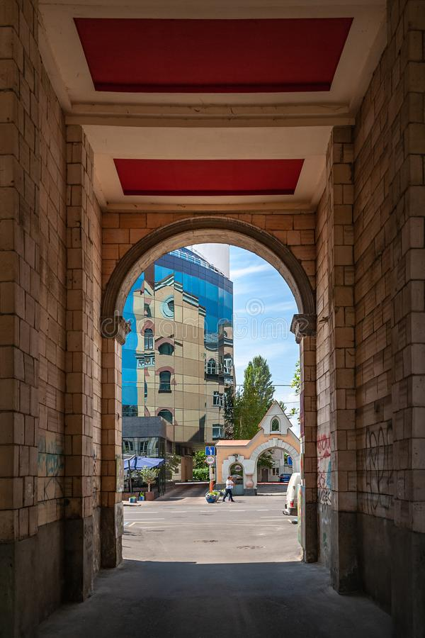 View from the dark arch of the gateway to the bright street. Weekend celebrations royalty free stock photography